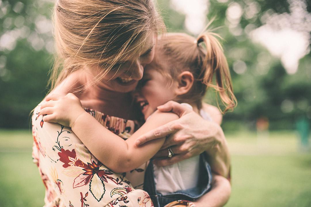 Mother hugging daugher